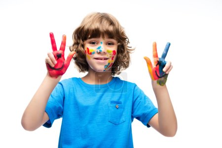 schoolboy showing painted fingers isolated on white