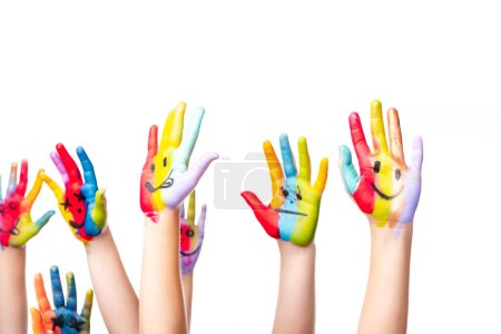 Photo for Cropped image of schoolchildren showing painted hands with smiley icons isolated on white - Royalty Free Image