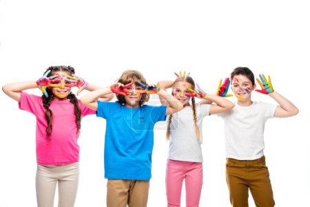 schoolchildren having fun and showing painted hands with smiley icons isolated on white