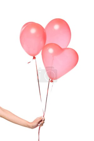 cropped image of girl holding bundle of heart shaped balloons isolated on white