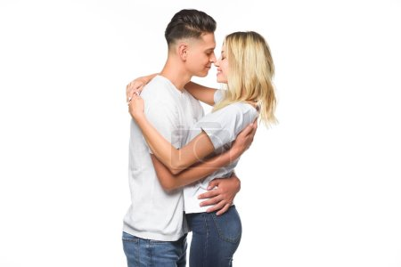 affectionate couple embracing and going to kiss isolated on white