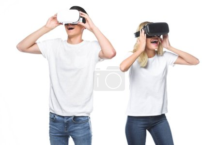 excited couple using virtual reality headsets isolated on white