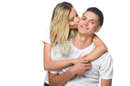 girlfriend kissing smiling boyfriend isolated on white