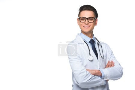 young male doctor in white coat with stethoscope posing with crossed arms, isolated on white