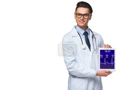 happy young doctor holding tablet with heart rate monitor on screen isolated on white