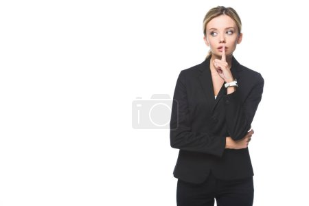 stylish young businesswoman showing silence sign isolated on white