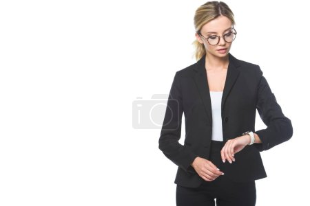 beautiful young businesswoman checking time with wrist watch isolated on white
