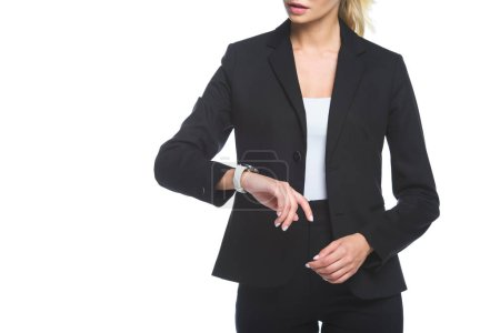 cropped shot of young businesswoman checking time with wrist watch isolated on white