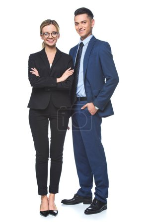happy business partners in suits looking at camera isolated on white