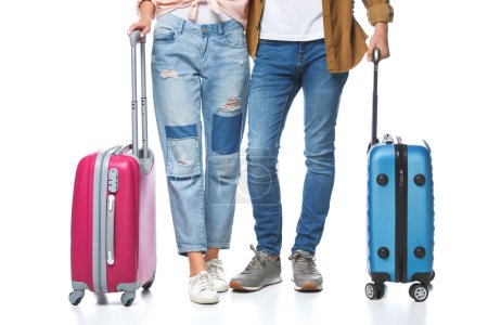 cropped shot of travelling couple with suitcases isolated on white