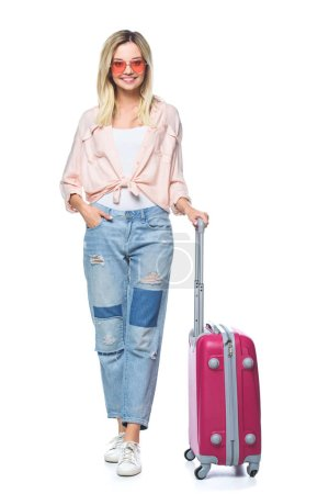 happy travelling woman with luggage looking at camera isolated on white