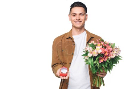 happy young man with bouquet making proposal isolated on white