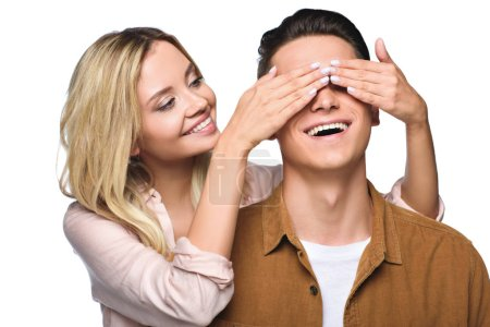happy young woman covering her boyfriends eyes from behind isolated on white