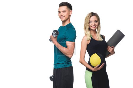 young fit couple with various equipment looking at camera isolated on white