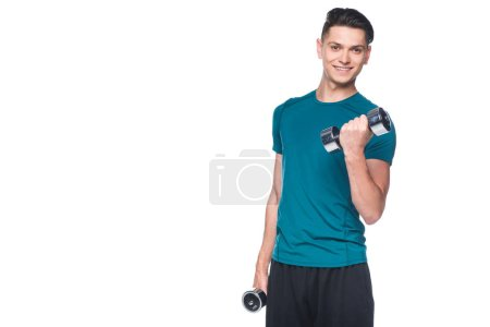 handsome young sportsman exercising with dumbbells isolated on white