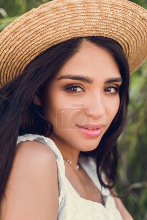 Photo for Portrait of attractive brunette girl in straw hat - Royalty Free Image