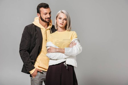 Photo for Stylish couple of models posing isolated on grey background - Royalty Free Image