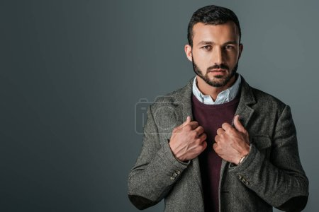 Photo for Handsome stylish man posing in trendy tweed jacket, isolated on grey - Royalty Free Image