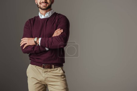 Photo for Cropped view of man posing in burgundy sweater with crossed arms, isolated on grey - Royalty Free Image