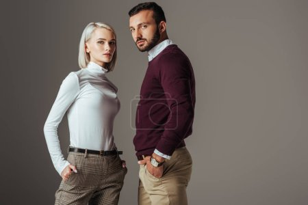 Photo for Couple posing in fashionable autumn outfit, isolated on grey - Royalty Free Image
