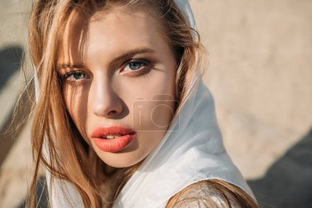 attractive blonde model posing in white silk scarf