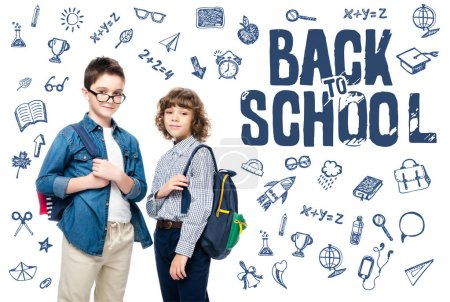 """two schoolboys with backpacks looking at camera isolated on white, with icons and """"back to school"""" lettering"""