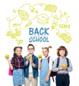 """smiling schoolchildren holding ripe apples isolated on white, with icons and """"back to school"""" lettering"""