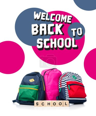 "three colored schoolbags and wooden cubes with word school isolated on white, with ""welcome back to school"" lettering"