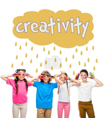 """schoolchildren having fun and showing painted hands with smiley icons isolated on white, with """"creativity"""" lettering in cloud with rain drops"""