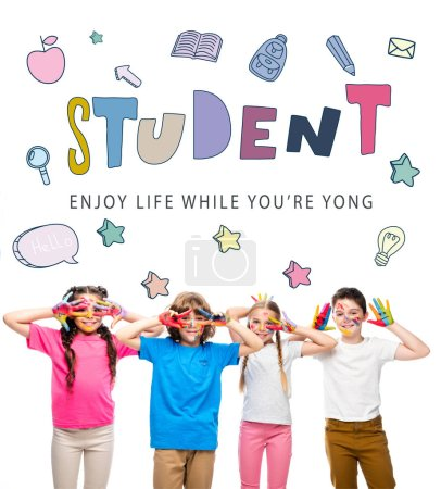 """Photo for Schoolchildren having fun and showing painted hands with smiley icons isolated on white, with """"student - enjoy life while youre yong"""" lettering - Royalty Free Image"""