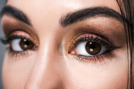 close up of beautiful female eyes with makeup