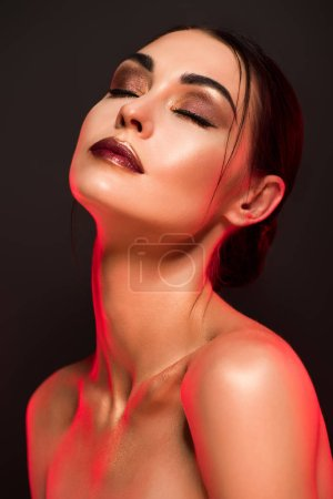 portrait of nude sensual girl with makeup isolated on grey, red toned picture