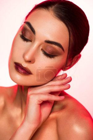 portrait of attractive tender girl with closed eyes, red toned picture