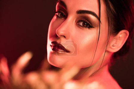 portrait of attractive model posing for fashion shoot, red toned picture