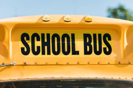 Photo for Close-up shot of school bus inscription over front window of bus - Royalty Free Image