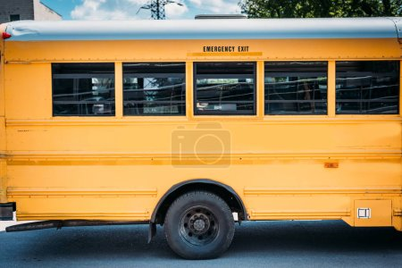 side view of parked empty school bus