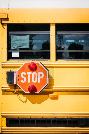 side view of school bus with stop sign