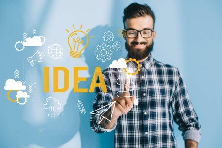 businessman in checkered shirt pointing at idea icons