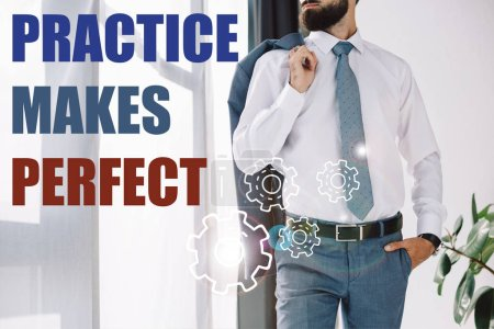 "cropped view of businessman standing near window with ""practice makes perfect"" lettering and gears"