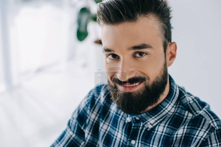 close-up portrait of handsome smiling man looking at camera
