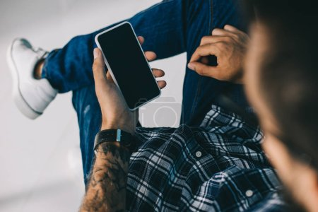 Photo for Cropped view of man using smartphone with blank screen - Royalty Free Image