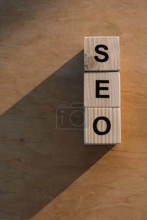 top view of wooden blocks making SEO word on wooden background