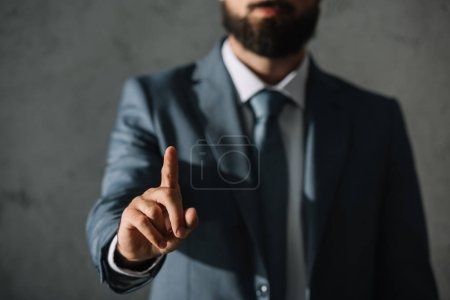 cropped view of businessman having idea and pointing up