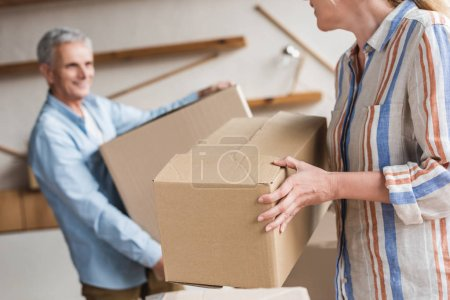 Photo for Cropped shot of senior couple holding cardboard boxes during relocation - Royalty Free Image