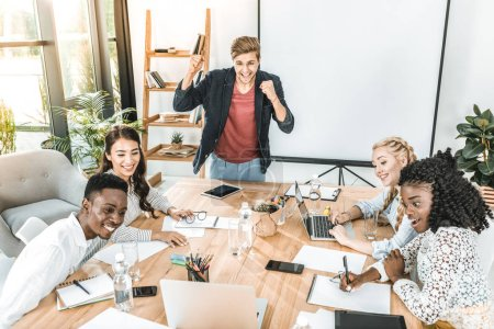 multicultural happy business team having conference at workplace in office