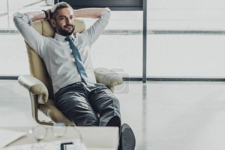 Photo for Handsome businessman relaxing on luxury armchair at modern office - Royalty Free Image