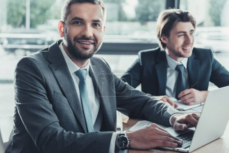 Photo for Handsome business people working together at modern office - Royalty Free Image