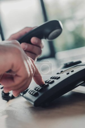 cropped shot of man making phone dial