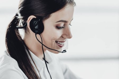 beautiful female call center worker with headphones