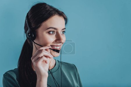 young smiling female support hotline worker isolated on blue